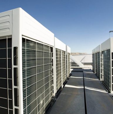 Picture of large refrigeration equipment on top of an industrial building in Apopka Florida.