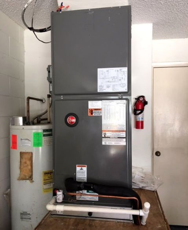 HVAC technician in central Florida work on commercial boiler and heating system.